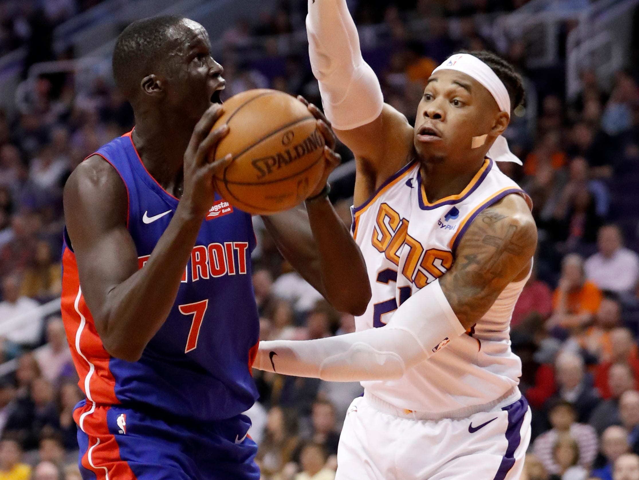 Detroit Pistons forward Thon Maker (7) prepares to shoot as Phoenix Suns forward Richaun Holmes defends during the first half.