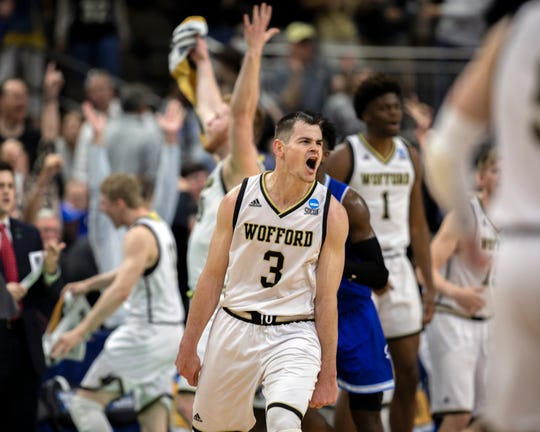 Wofford guard Fletcher Magee (3) celebrates with teammates after hitting a 3-point basket during the final moments of the second half against Seton Hall.