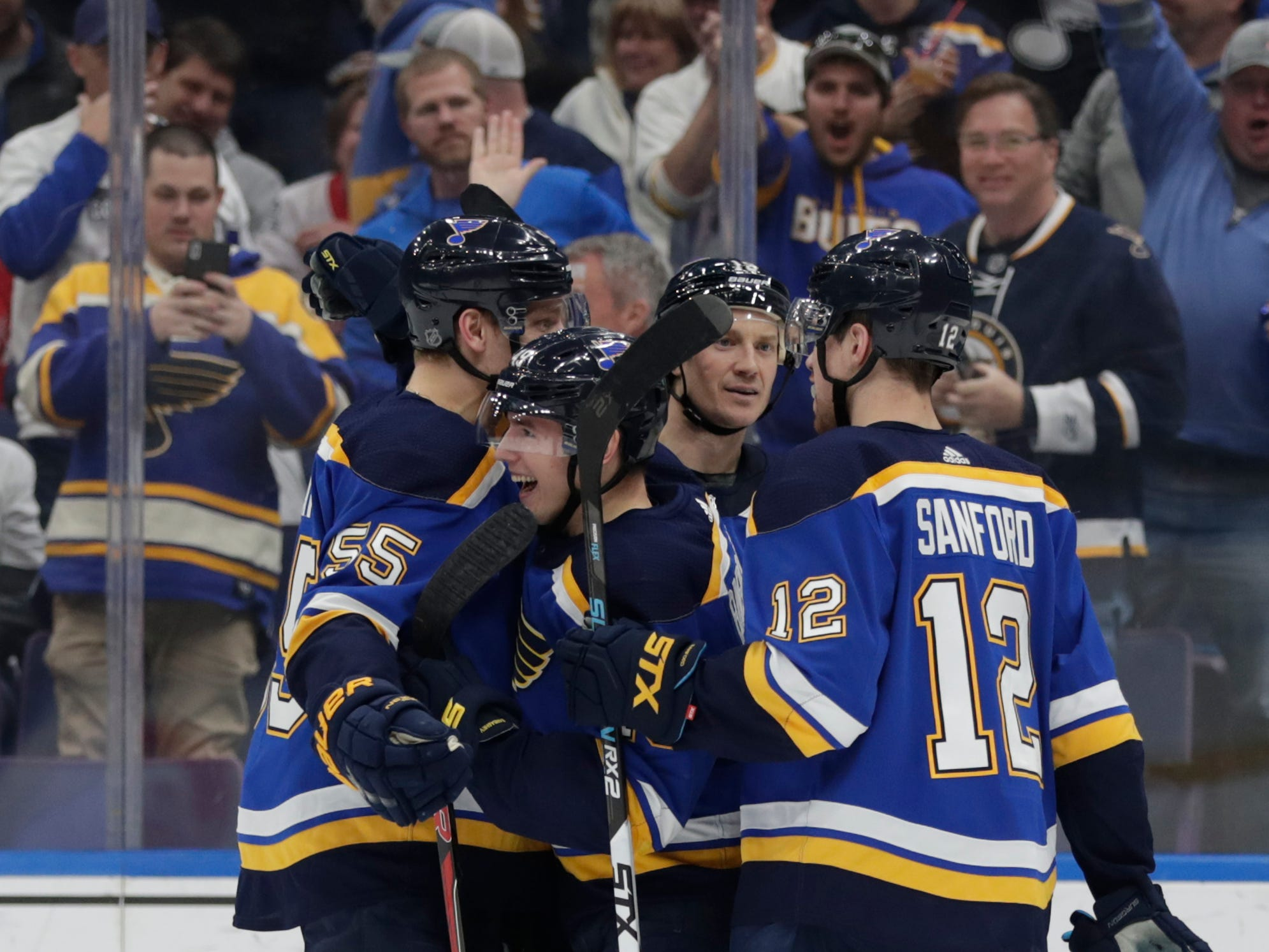 St. Louis' Ivan Barbashev, center, celebrates with teammates Colton Parayko (55), Zach Sanford (12) and Jay Bouwmeester after scoring a goal.