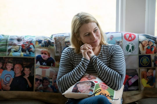 Tammi Carr sits for an interview at her home in Ann Arbor. Tammi's son Chad, whose image is imprinted onto the blanket and pillow on the couch, died from a brain tumor known as a diffuse intrinsic pontine glioma on Nov. 23, 2015.