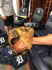 Jordy Mercer holds his Rawlings Gold Glove mitt, which he has used since 2009.