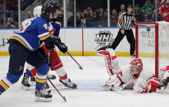 St. Louis' Ivan Barbashev shoots the puck over Detroit goaltender Jonathan Bernier.