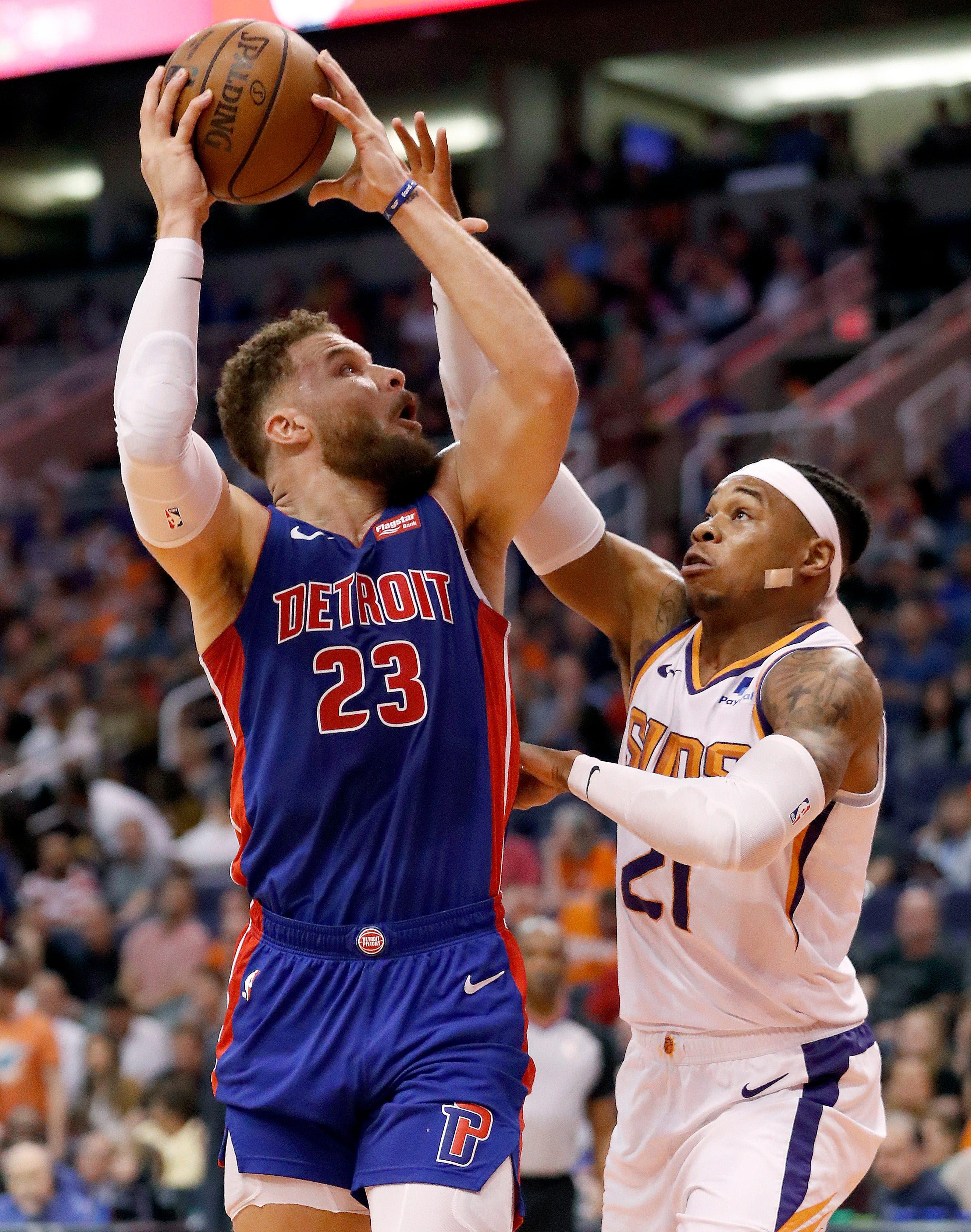 Detroit Pistons forward Blake Griffin (23) shoots over Phoenix Suns forward Richaun Holmes (21) during the first half.