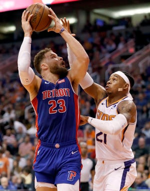 Detroit Pistons forward Blake Griffin (23) shoots over Phoenix Suns forward Richaun Holmes (21) during the first half.