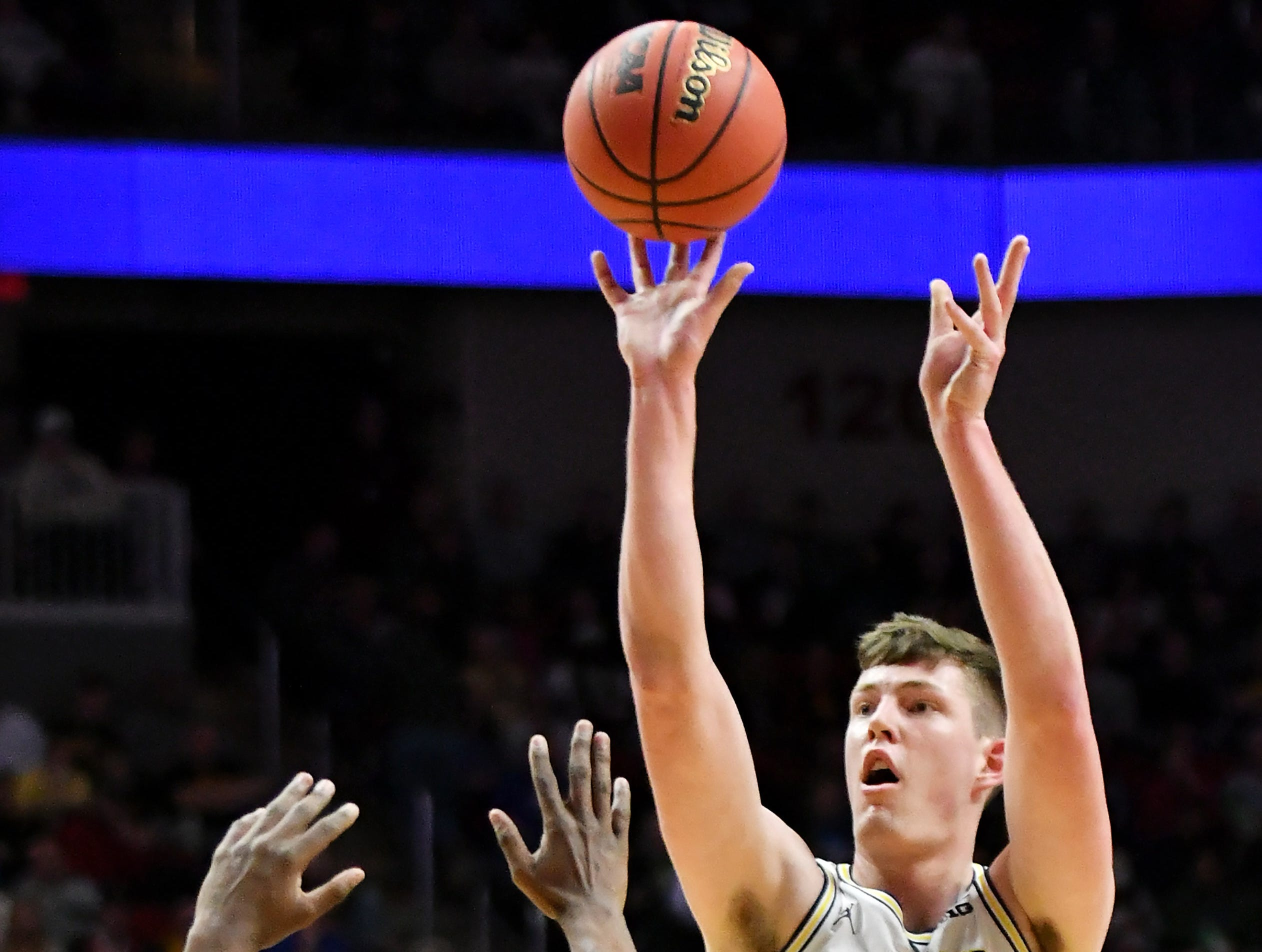 Michigan center Jon Teske (15) shoots over Montana guard Sayeed Pridgett (4) in the first half.  Michigan vs Montana for Round 1 of the NCAA Tournament at Wells Fargo Arena in Des Moines, Iowa on March. 21, 2019.