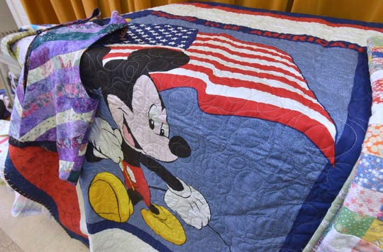 This Proud To Be American Mickey Mouse quilt will be donated to a U.S. veteran or the family of a U.S. serice member.