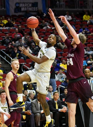 Guard Zavier Simpson trotted out a running hook pass, which is similar to his running hook shot, in the second half of Michigan's 74-55 victory over Montana Thursday.