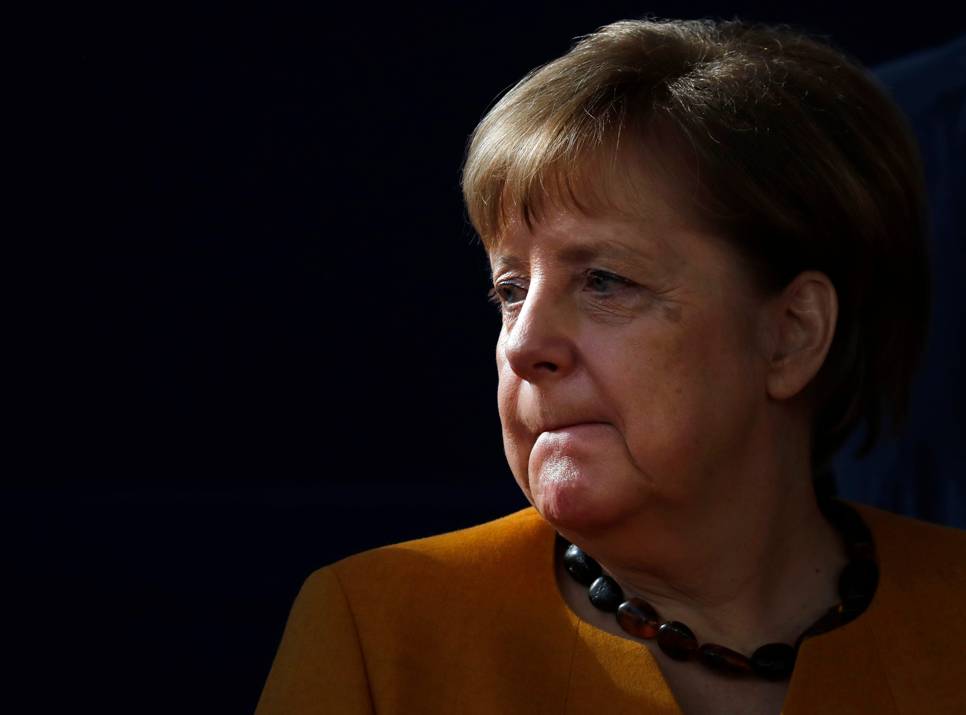 German Chancellor Angela Merkel waits for the start of a group photo at an EU summit in Brussels, Friday, March 22, 2019. European Union leaders gathered again Friday after deciding that the political crisis in Britain over Brexit poses too great a threat and that action is needed to protect the smooth running of the world's biggest trading bloc.