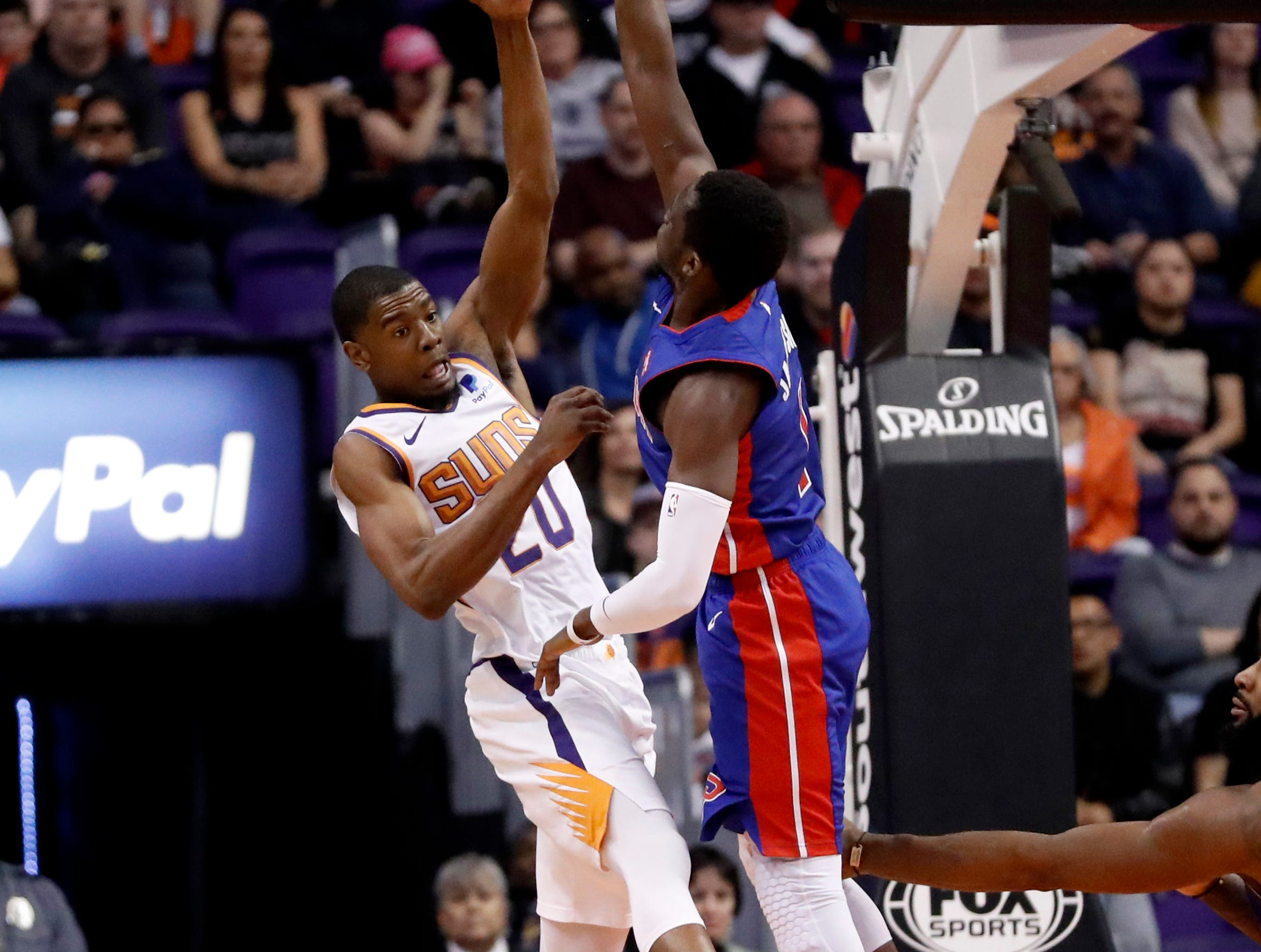 Phoenix Suns forward Josh Jackson (20) passes the ball over Detroit Pistons center Andre Drummond during the first half.