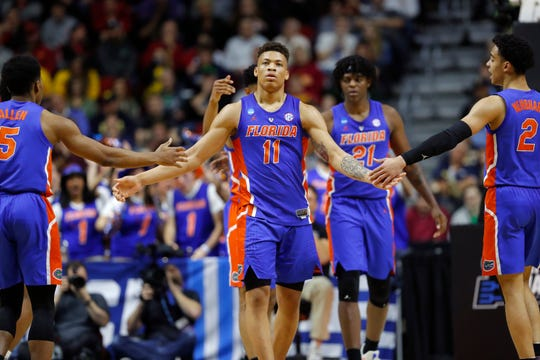 Florida forward Keyontae Johnson celebrates with teammates after making a basket during the win over Nevada.