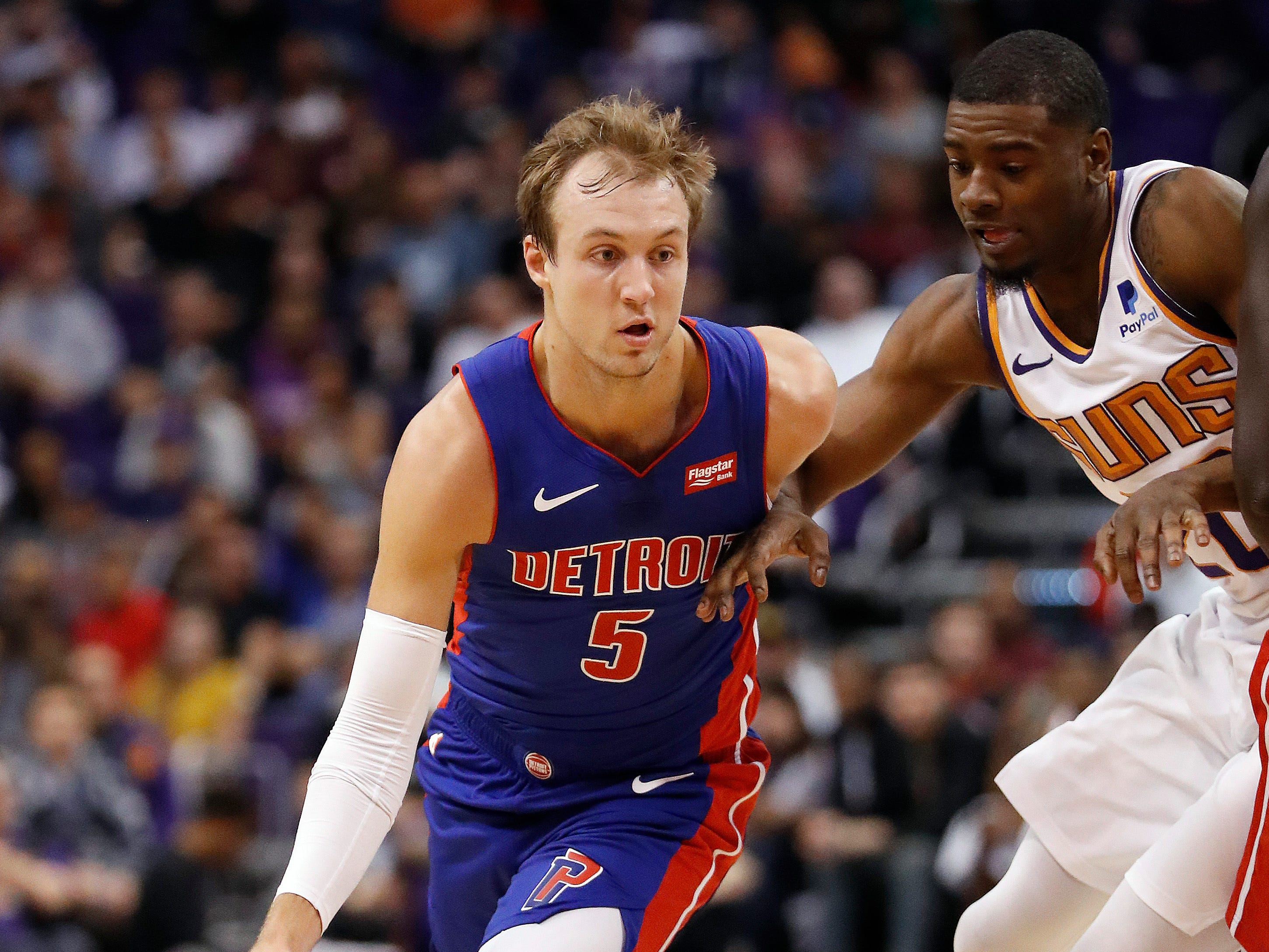 Detroit Pistons guard Luke Kennard (5) dries against the Phoenix Suns during the first half.