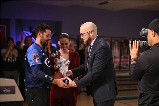 Jason Belmonte collects his second trophy of the week in Allen Park.