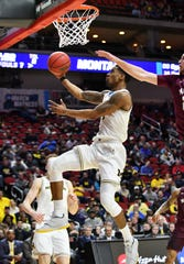 Michigan guard Charles Matthews (1) goes to the basket in the second half. He finished with 22 points and 10 rebounds in the Wolverines' 74-55 win over Montana on Thursday in the NCAA Tournament.