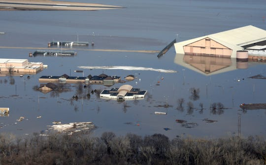 An aerial view of Offutt Air Force Base and the surrounding areas affected by flood waters in Neb. on March 17.