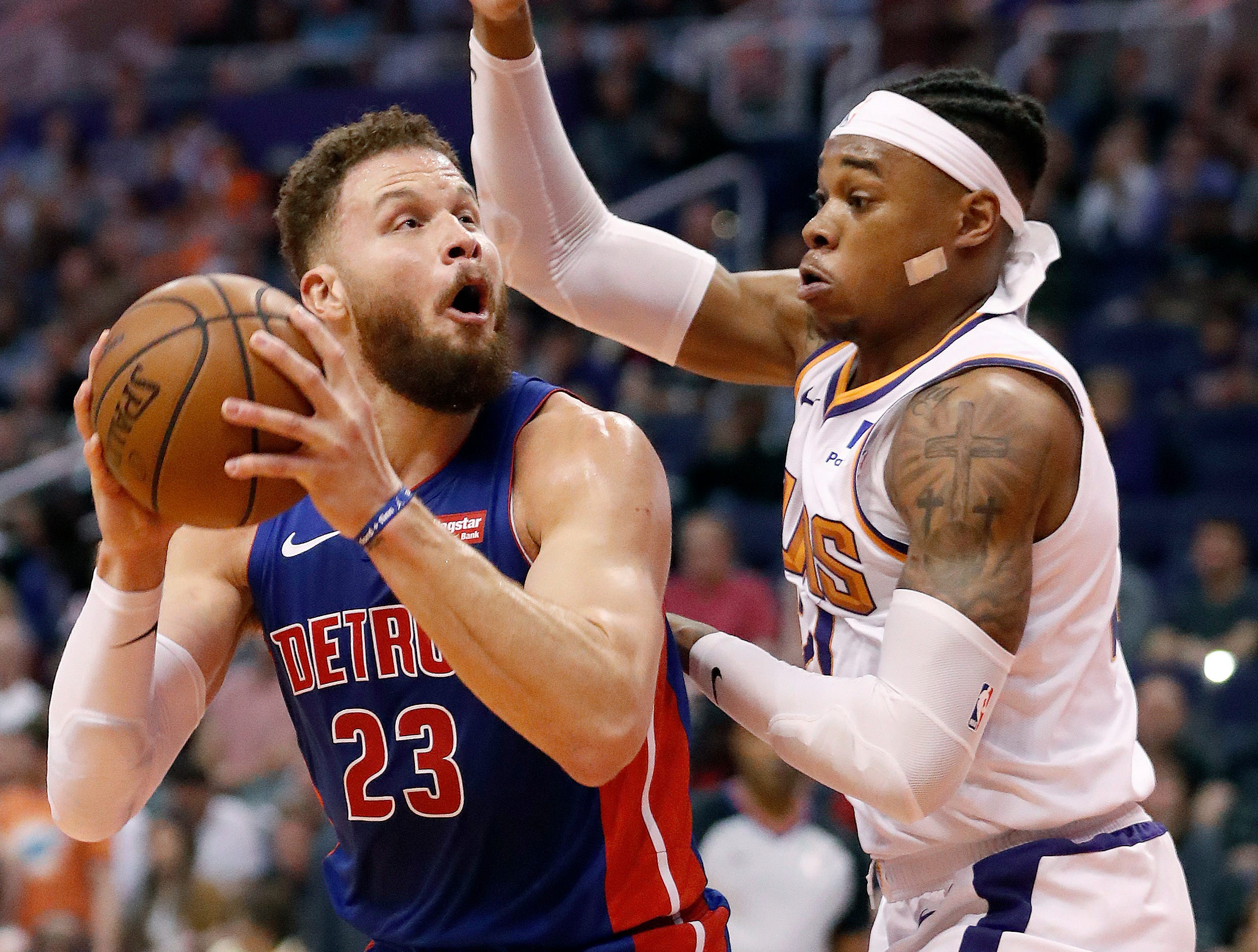 Detroit Pistons forward Blake Griffin (23) shoots over Phoenix Suns forward Richaun Holmes during the first half.