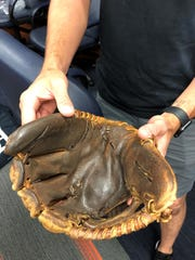 """""""I've had surgery on it a couple of times,"""" Jordy Mercer says of his 10-year-old glove."""