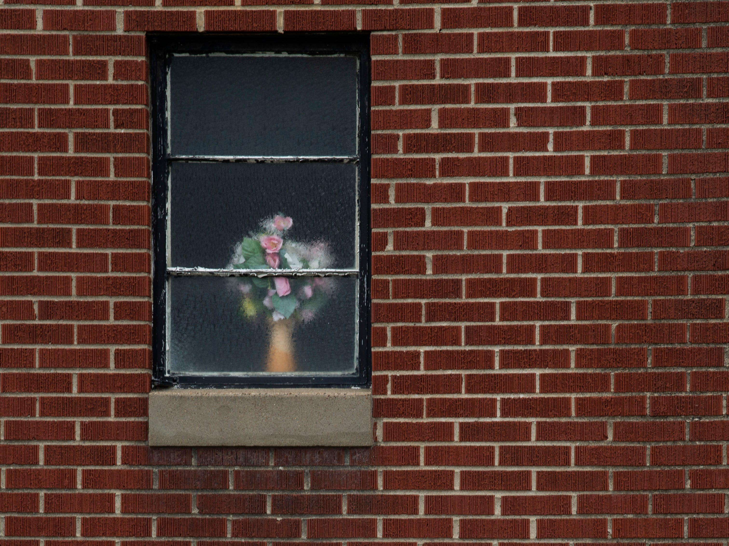 Flowers adorn the window of Independence Missionary Baptist Church on Virginia Street Wednesday afternoon. The church was built in 1884.