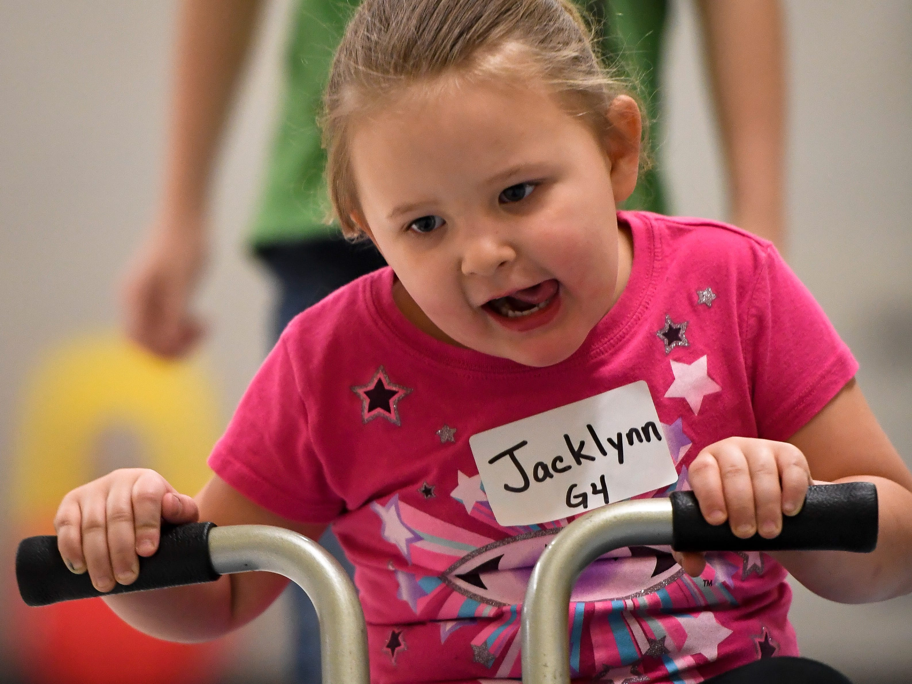 Jacklynn Wright rounds a corner in the bike race competition during the Special Olympics Unified Champion School Young Athlete program at Culver Early Learning Center Friday, March 22, 2019.