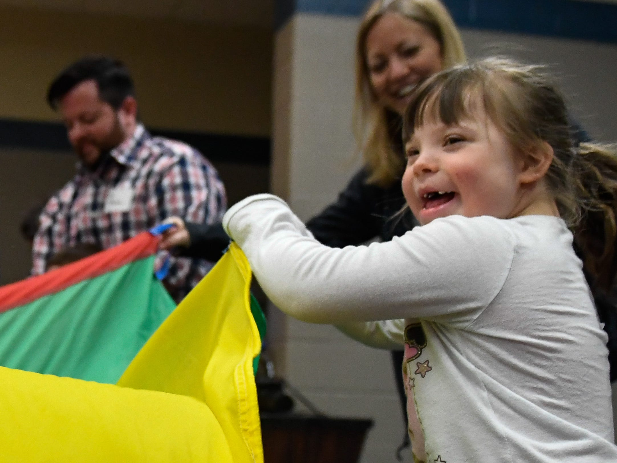 Emelia Carmack, 9 years-old, plays with a parachute during the Special Olympics Unified Champion School Young Athlete program at Culver Early Learning Center Friday, March 22, 2019.