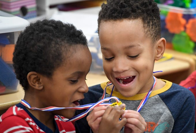 Gold medalists Terrick Gulett, left, and A.J. Severino look at their medals during the Special Olympics Unified Champion School Young Athlete program at Culver Early Learning Center Friday, March 22, 2019.