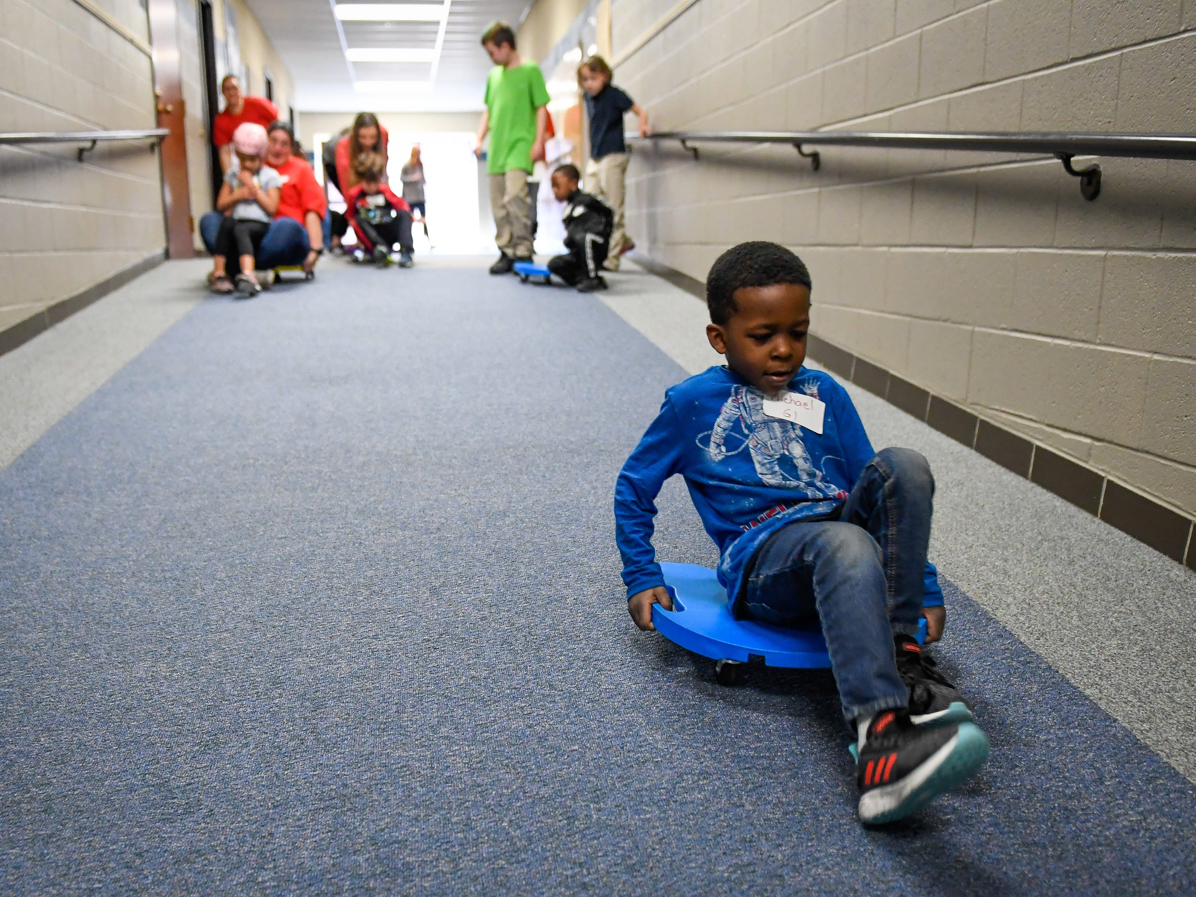 Michael Higginson takes first place in the scooter race during the Special Olympics Unified Champion School Young Athlete program at Culver Early Learning Center Friday, March 22, 2019.