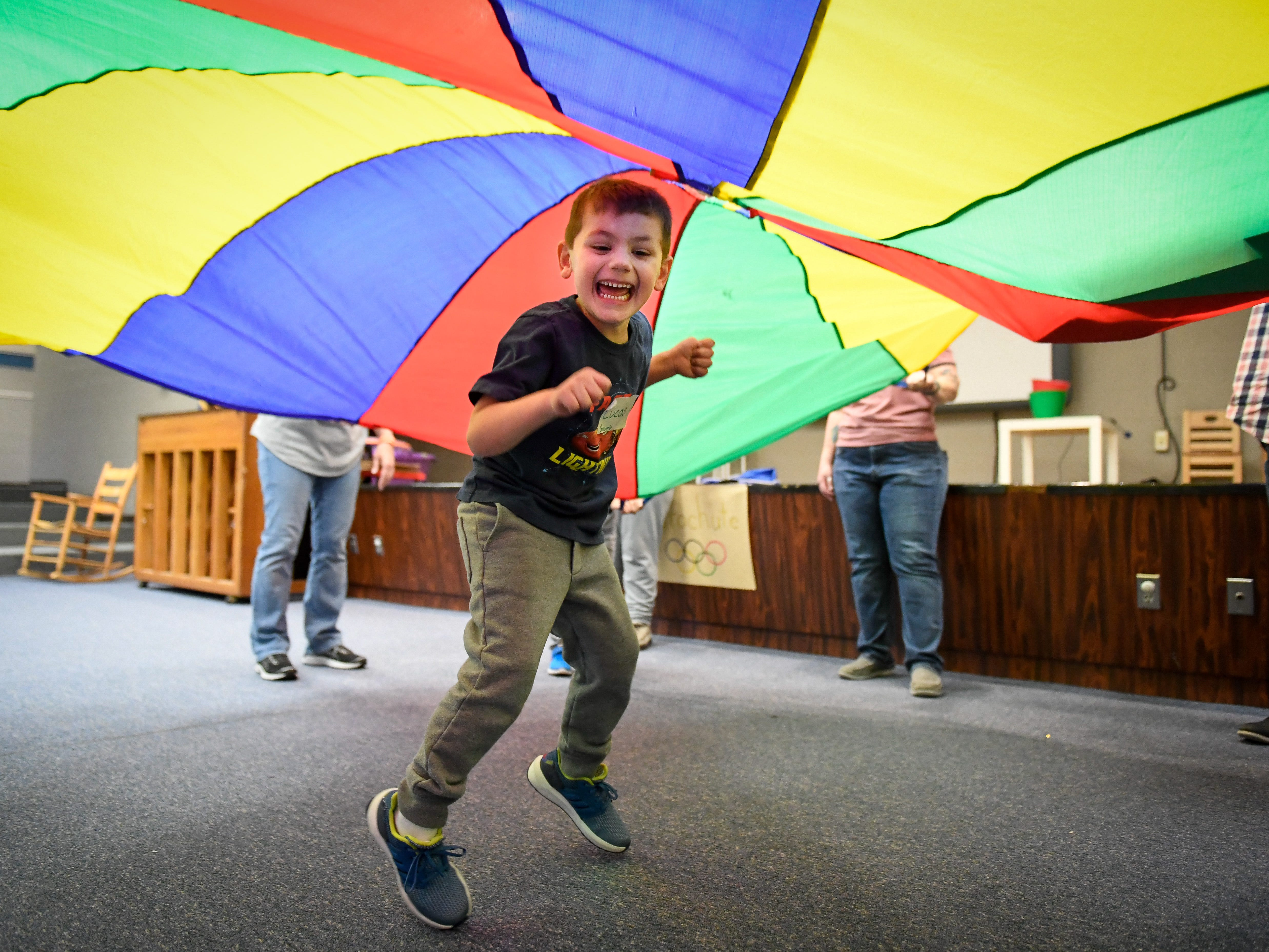Taking his turn, Lucas Spanner, 9 years-old, plays under a parachute during the Special Olympics Unified Champion School Young Athlete program at Culver Early Learning Center Friday, March 22, 2019.