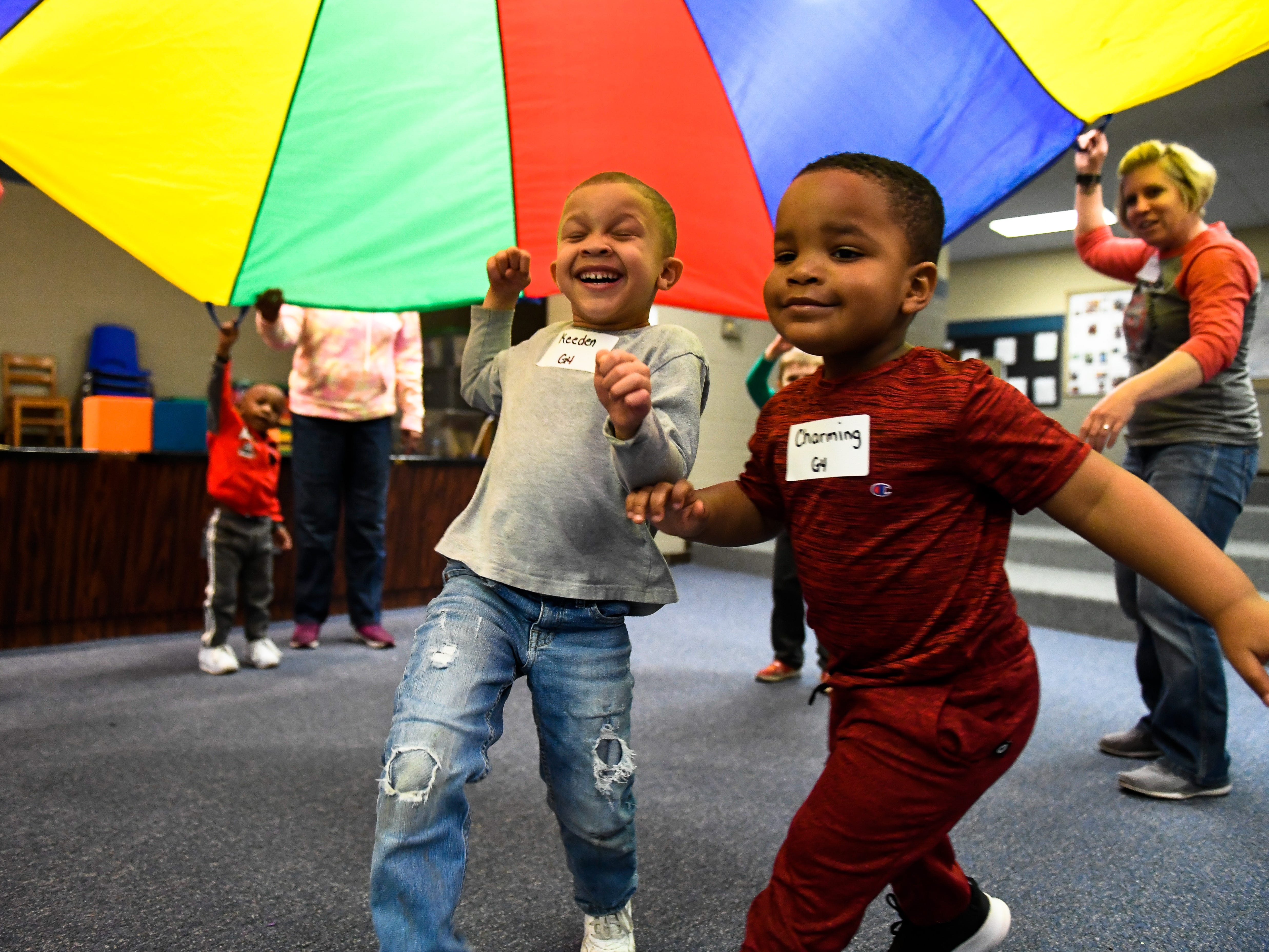 Keeden Roach, 5 years-old, left, and Charming Leach, 3 years-old, play under the parachute during the Special Olympics Unified Champion School Young Athlete program at Culver Early Learning Center Friday, March 22, 2019.