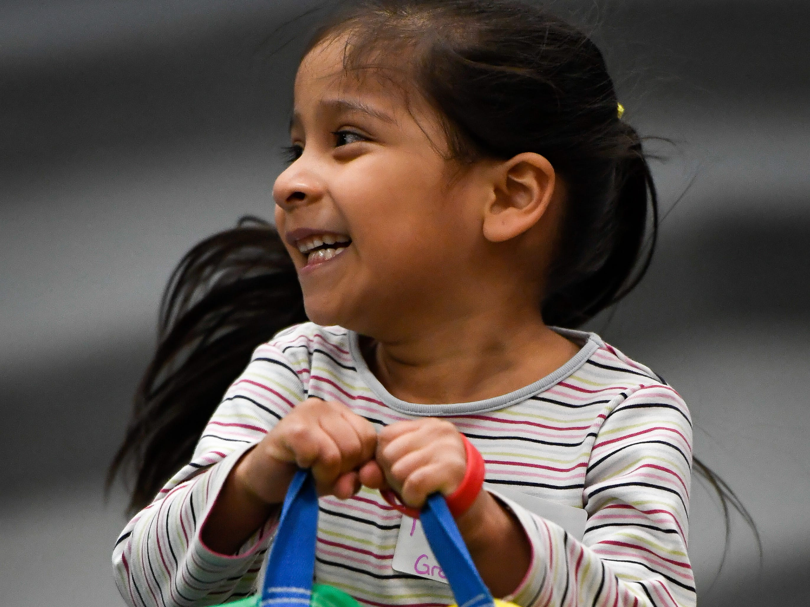 Marissa Sanchez, 4 years-old, does her part holding up the side of the parachute during the Special Olympics Unified Champion School Young Athlete program at Culver Early Learning Center Friday, March 22, 2019.