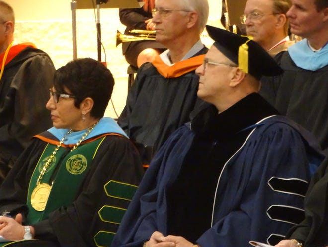 Terra State Community College President Ron Schumacher and his wife, Lillian Schumacher, president of Tiffin University, listen to a speaker at Friday's presidential inauguration ceremony at the college. Ron Schumacher is Terra State's seventh president.