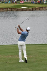 Brooks Koepka hitting his tee shot on the 17th hole during the third round of the 2019 Players Championship at TPC Sawgrass.
