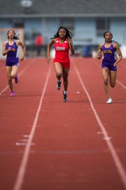 Fort Collins High School's Dominique Chesson, right, overtakes Rangeview's Ayana Brown to win the 200-meter dash Friday at the Runners Roost Invitational at French Field. Fort Collins won the boys and girls team titles in the 21-team meet.