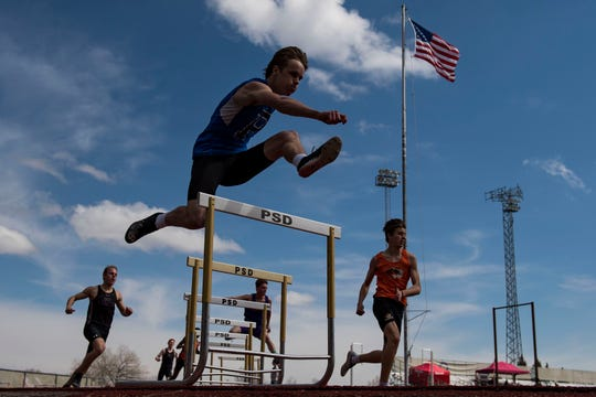 Poudre High School's Hunter Greenlee competes in the boys 300-meter hurdles during the Runners Roost of Fort Collins Invite on Friday, March 22, 2019, at French Field in Fort Collins, Colo.
