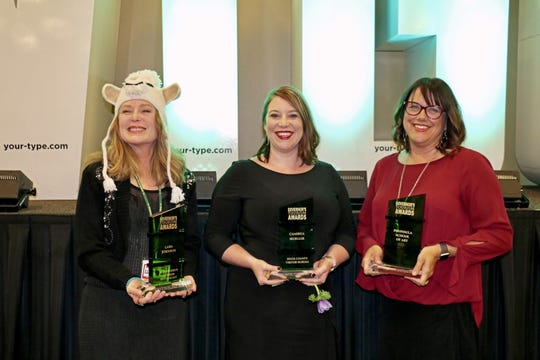 Three Governor's Tourism Awards were presented to Door County recipients during the Wisconsin Governor's Conference on Tourism on March 19. Accepting the awards were, from left: Mickie Rasch, representing Al Johnson's Swedish Restaurant; Cambria Mueller, marketing manager for the Door County Visitor Bureau; and Catherine Hoke, executive director of the Peninsula School of Art.