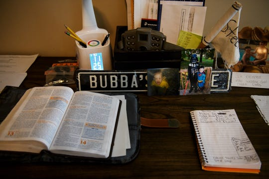 A bible, handwritten notes and other personal items are laid out on Brandon Tyson's desk Monday, March 18, 2019.
