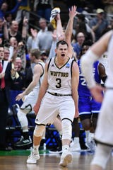 Wofford Terriers guard Fletcher Magee (3) celebrates after scoring against the Seton Hall Pirates during the second half in the first round of the 2019 NCAA Tournament at Jacksonville Veterans Memorial Arena.