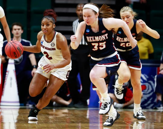South Carolina guard Te'a Cooper (2) drives upcourt after stealing the ball from Belmont's Conley Chinn, right, during a first-round game in the NCAA women's college basketball tournament in Charlotte, N.C., Friday.