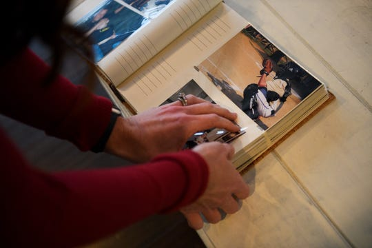 Nikki Tyson shows photographs of her 17-year-old son Brandon in her home Monday, March 18, 2019.