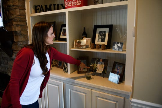 Nikki Tyson shows photographs of her son, Brandon, in their home March 18, 2019.
