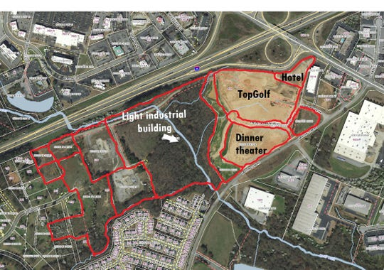 "All the parcels outlined here in red -- 85 acres -- belong to Neil Wilson's RealtyLink firm. Dubbed ""Garlington North,"" the site at Interstate 85 and Pelham Road includes 38 acres northeast of Rocky Creek and 47 acres southwest of the creek. TopGolf is the leading tenant of the development and will be the first to open. A dinner theater and light industrial building southwest of the creek could be next, Wilson says."