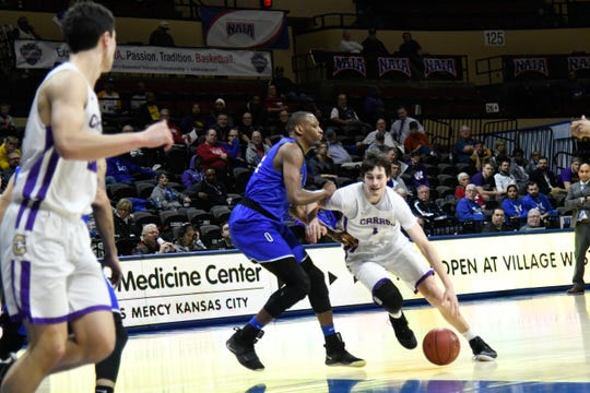 Carroll College's Match Burnham dribbles against the Oklahoma City defense Friday at the NAIA Tournament in Kansas City.
