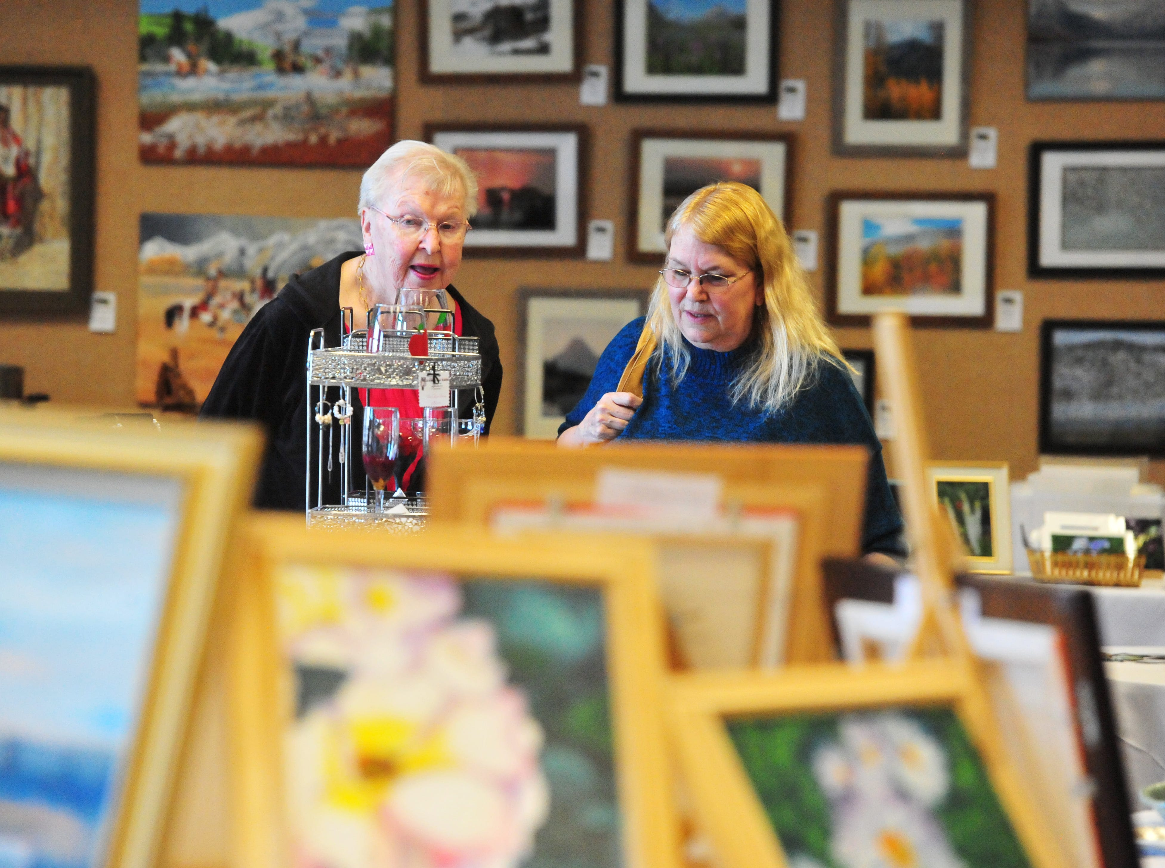 Donna Sanders and her daughter Colleen Broeker view the art on display at the Studio 706 Artist Guild Art Show in the Gibson Room of the Great Falls Civic Center, Thursday.