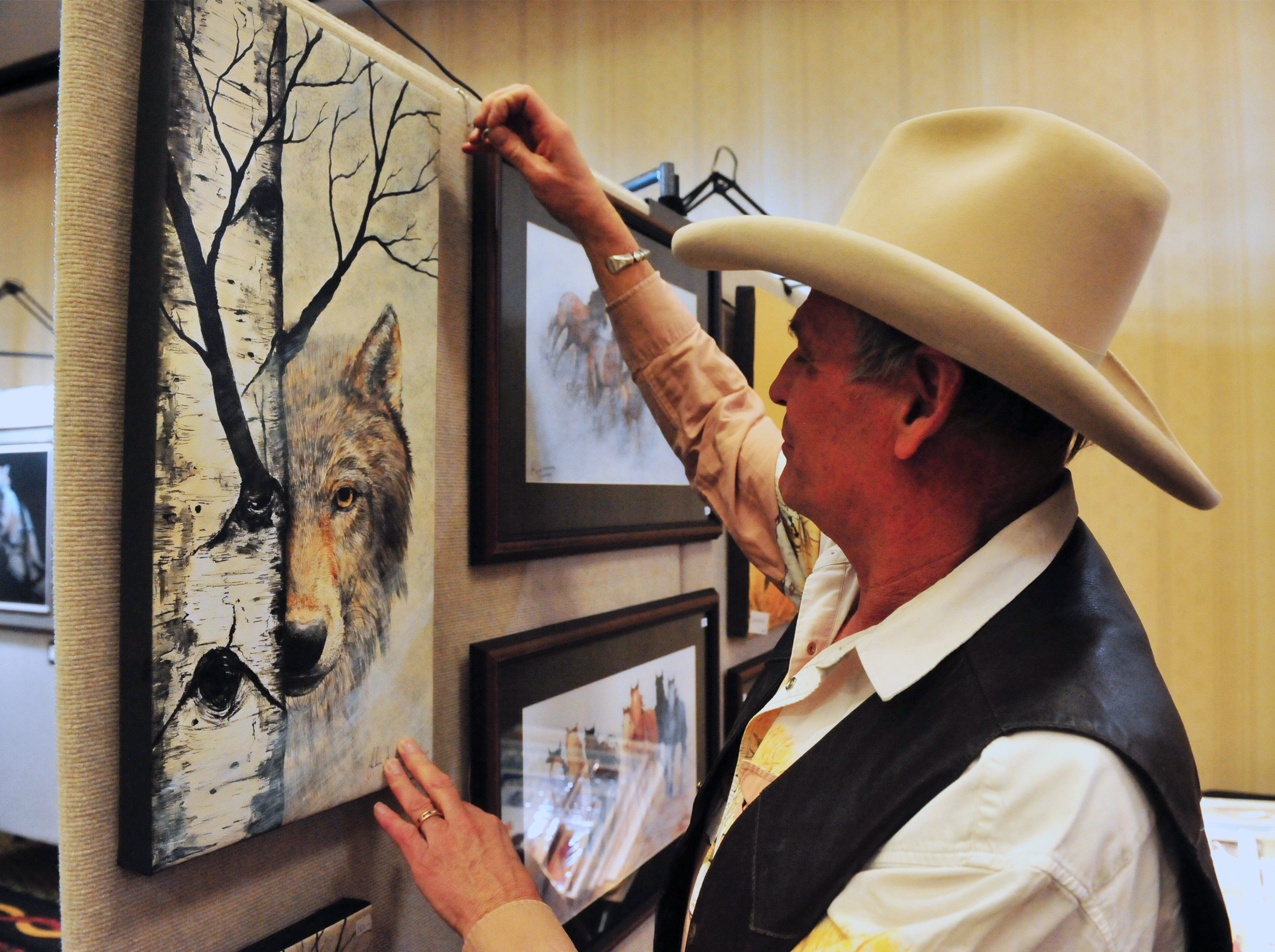 John Saunders straightens one of his pieces at the Jay Contway and Friends Show at the Hilton Garden Inn, Thursday.