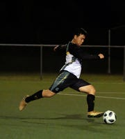 A University of Guam soccer player is shown in this file phoyo, The Tritons won by forfeit Thursday over the Pago Bay Disasters in the Guam Football Association Budweiser Amateur Men's League.