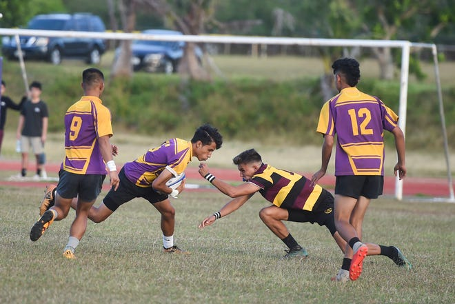 George Washington's Ipu Indalecio runs toward Father Duenas player Joseph Green during the IIAAG Boys Rugby Finals at the GW High School Field in Mangilao, in this March 22 file photo.