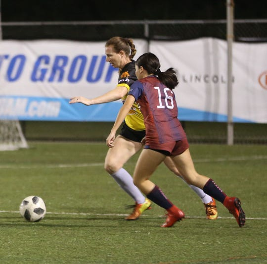 NAPA Lady Rovers' Melissa Elwell plays the ball out from the back against the Bank of Guam Lady Strykers in a Week 10 match of the Bud Light Women's Soccer League Premier Division at the Guam Football Association National Training Center. The Lady Strykers defeated the Lady Rovers 6-0.