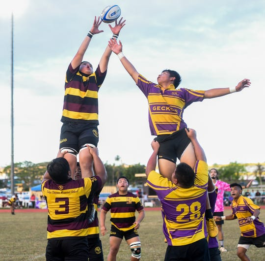 The Geckos and the Friars battle during the IIAAG/GRFU Boys Rugby championship at GW High on March 22. The Friars had six players named to the All Island First Team, the Geckos had three.