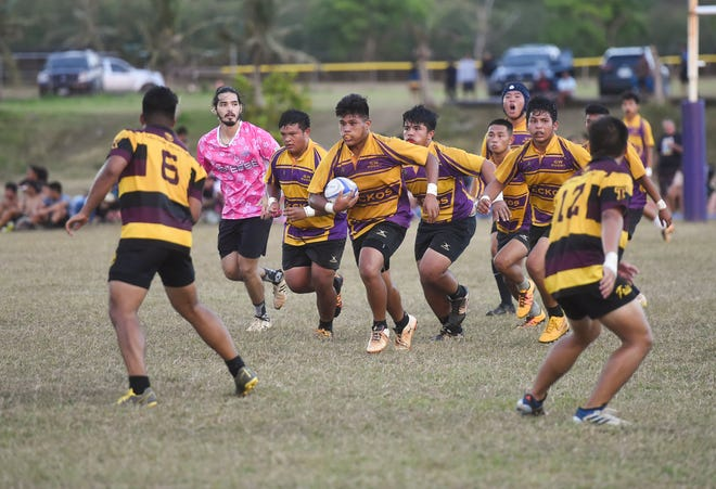 In this file photo from March 2019, George Washington's Jose San Miguel runs the ball against the Father Duenas Friars during the IIAAG Boys Rugby championship at the GW High School Field in Mangilao. Guam High School joins the new high school rugby league for 2020.