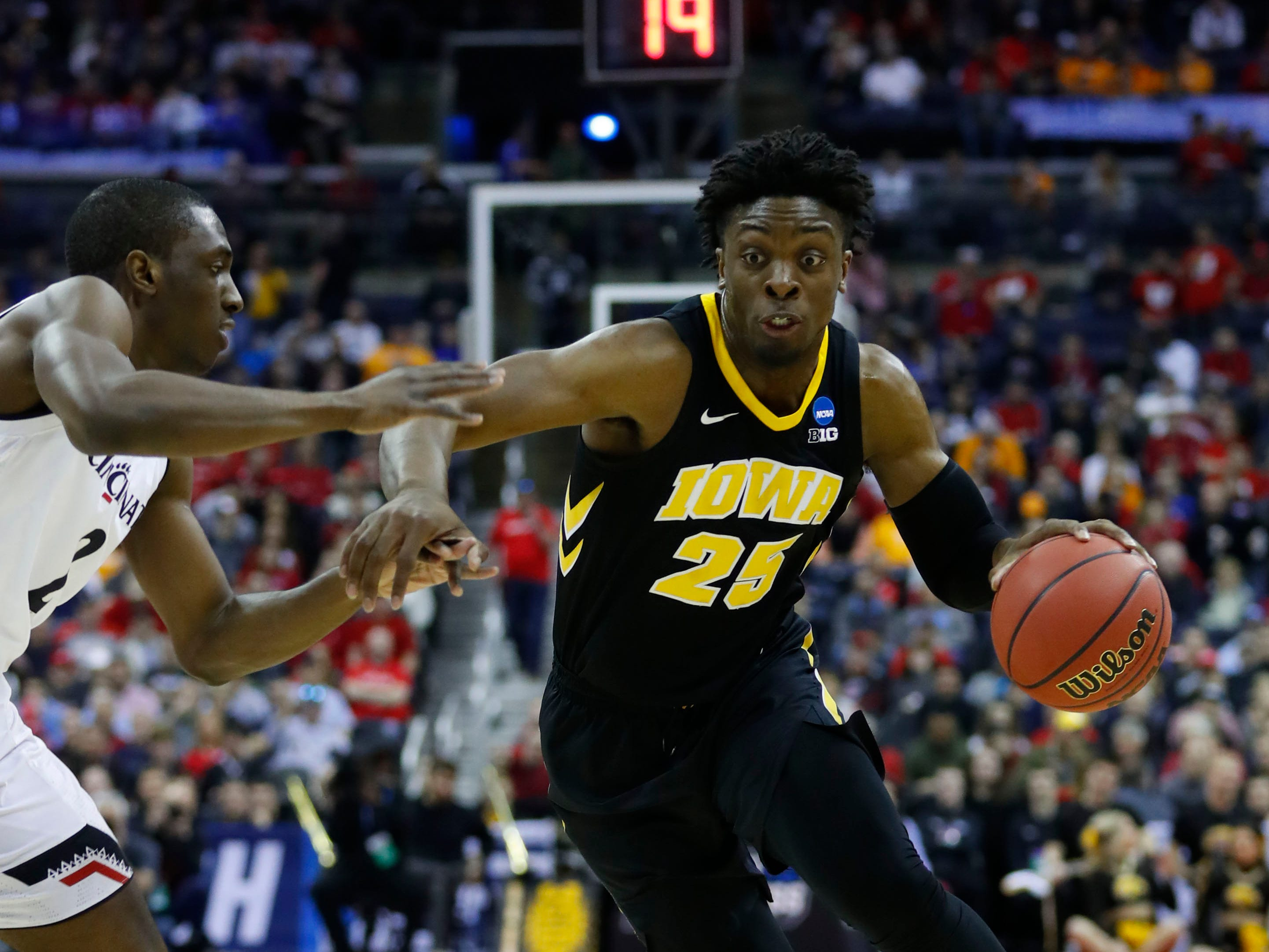 Mar 22, 2019; Columbus, OH, USA; Iowa Hawkeyes forward Tyler Cook (25) drives down court defended by Cincinnati Bearcats guard Keith Williams (2) in the first half in the first round of the 2019 NCAA Tournament at Nationwide Arena. Mandatory Credit: Rick Osentoski-USA TODAY Sports