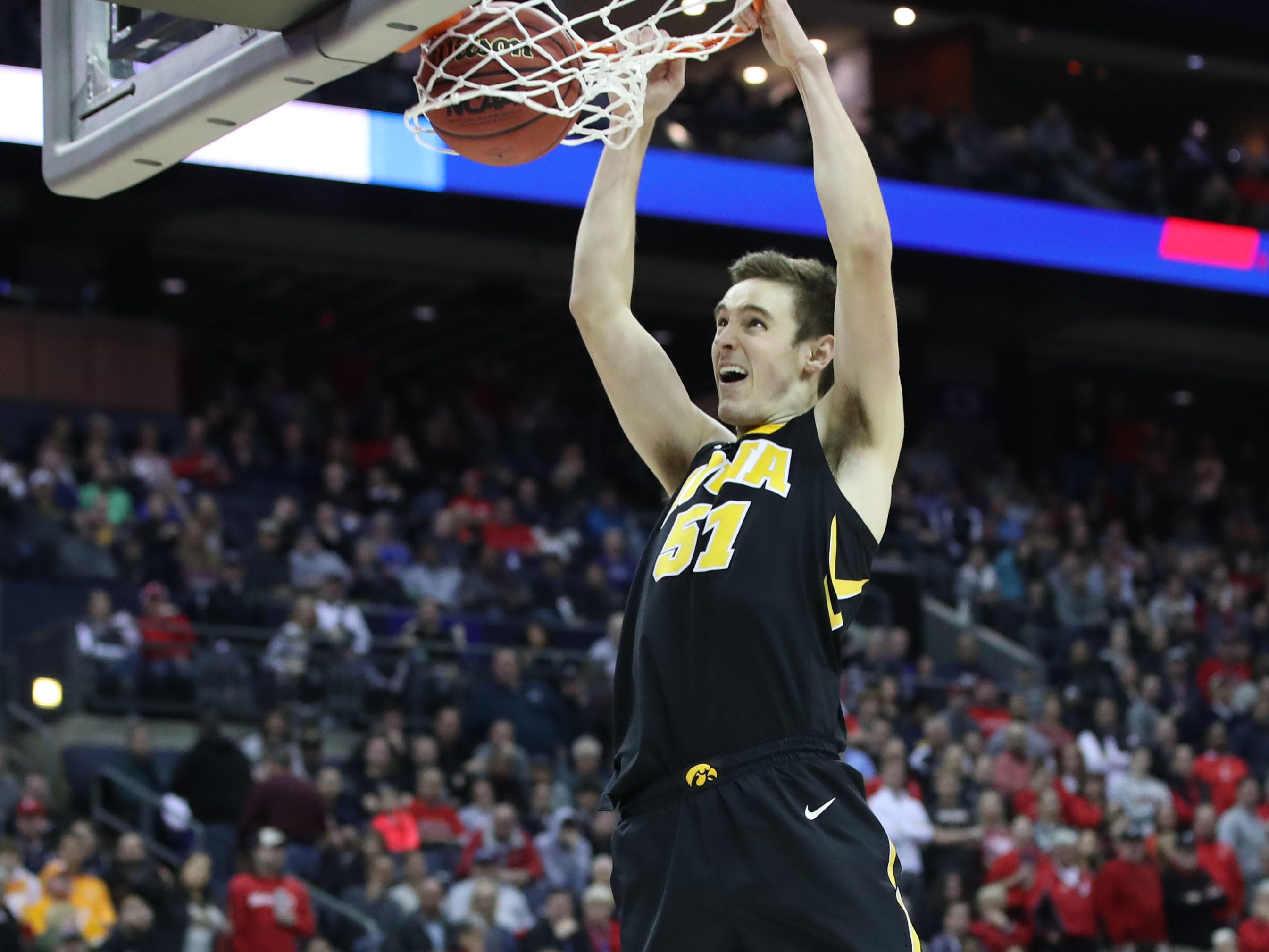 Iowa Hawkeyes forward Nicholas Baer (51) dunks the ball in the second half against the Cincinnati Bearcats in the first round of the 2019 NCAA Tournament at Nationwide Arena on March 22, 2019.