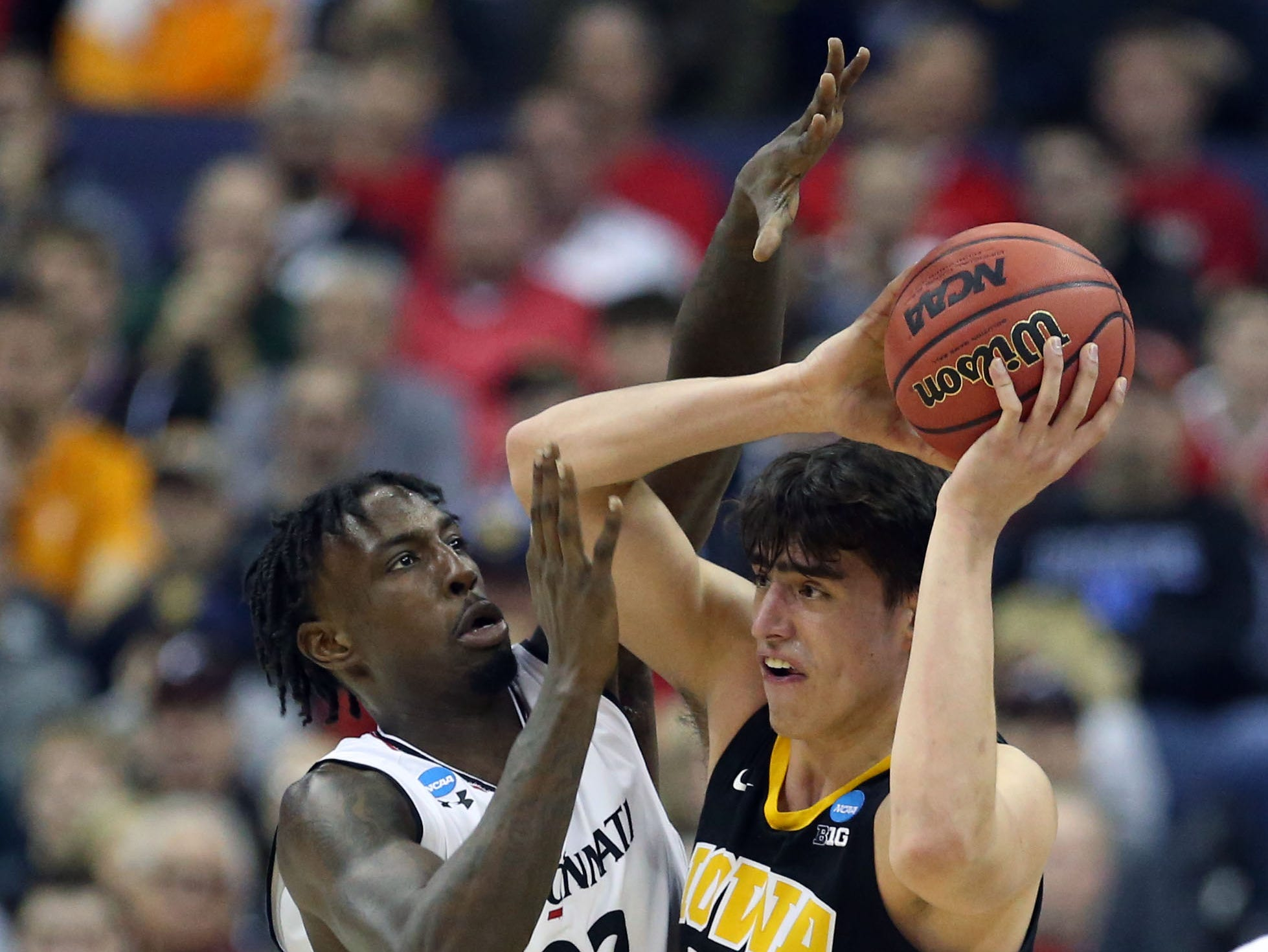 Mar 22, 2019; Columbus, OH, USA; Iowa Hawkeyes forward Luka Garza (55) fight to keep control of the ball defended by Cincinnati Bearcats center Nysier Brooks (33) in the first half in the first round of the 2019 NCAA Tournament at Nationwide Arena. Mandatory Credit: Kevin Jairaj-USA TODAY Sports